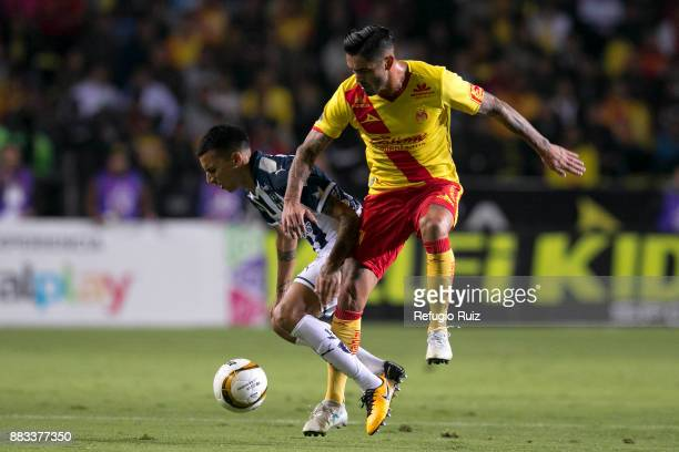 Rodrigo Millar of Morelia fights for the ball with Leonel Vangioni of Monterrey during the semifinal first leg match between Morelia and Monterrey as...