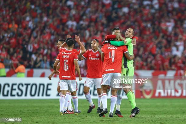 Rodrigo Moledo of Internacional celebrates with teammate Marcelo Lomba after winning the match between Internacional and Tolima as part of Copa...