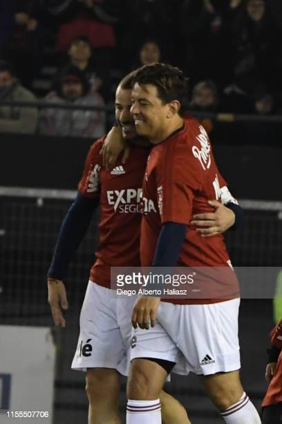 Rodrigo Mora and Marcelo Gallardo celebrate one goal during the farewell match of Uruguayan player Rodrigo Mora at Estadio Monumental Antonio...