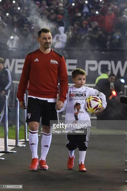 Rodrigo Mora and your sun Maximo during the farewell match of Uruguayan player Rodrigo Mora at Estadio Monumental Antonio Vespucio Liberti on July 13...
