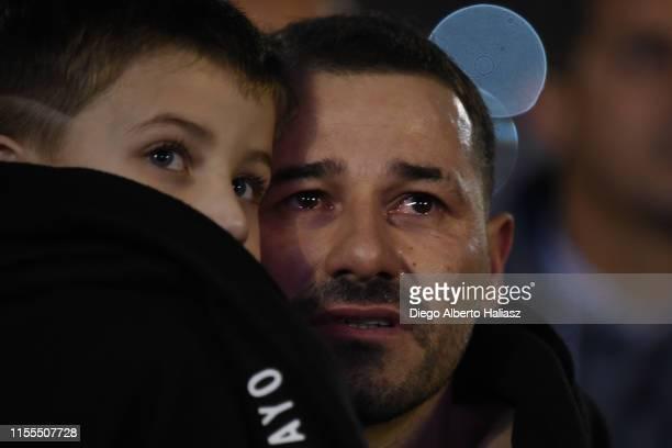 Rodrigo Mora cries as hi carries his son Maximo after the farewell match of Uruguayan player Rodrigo Mora at Estadio Monumental Antonio Vespucio...