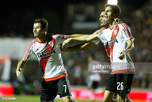Rodrigo Mora of River Plate celebrates with teammates Ignacio Fernandez and Gabriel Mercado after scoring the first goal of his team during a match...