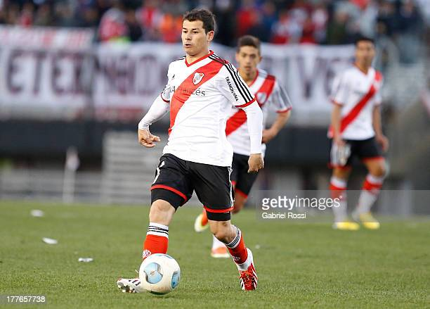 Rodrigo Mora of River Plate drives the ball during a match between River Plate and Colon de Santa Fe as part of the Torneo Inicial 2013 at Monumental...