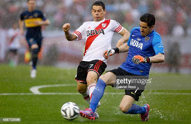 Rodrigo Mora of River Plate fights for the ball with Agustin Orion of Boca Juniors during a match between River Plate and Boca Juniors as part of...