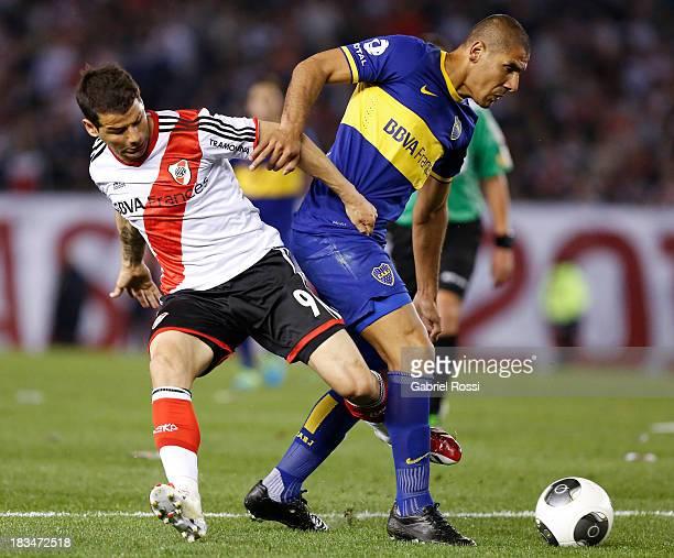 Rodrigo Mora of River Plate fights for the ball with Daniel Diaz of Boca Juniors during a match between River Plate and Boca Juniors as part of the...