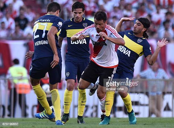 Rodrigo Mora of River Plate fights for the ball with Fernando Gago Santiago Vergini and Sebastian Perez of Boca Juniors during a match between River...