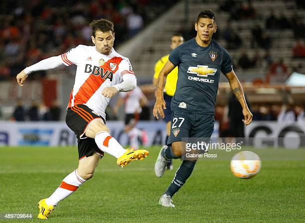 Rodrigo Mora of River Plate kicks the ball during a first leg match between River Plate and Liga Deportiva Universitaria de Quito as part of round of...