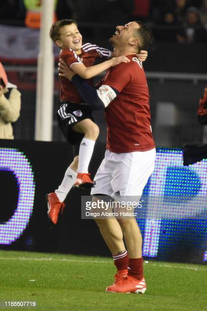 Rodrigo Mora plays with his son Maximo during the farewell match of Uruguayan player Rodrigo Mora at Estadio Monumental Antonio Vespucio Liberti on...