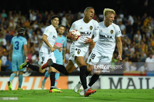 Rodrigo Moreno Machado of Valencia celebrates with team mates after scoring his side's first goal during the La Liga match between Valencia CF and...