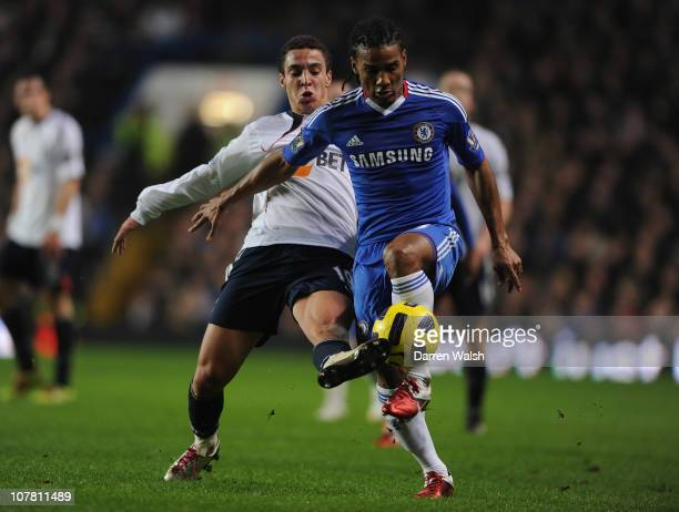 Rodrigo Moreno of Bolton Wanderers tackles Florent Malouda of Chelsea during the Barclays Premier League match between Chelsea and Bolton Wanderers...