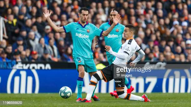 Rodrigo Moreno of FC Valencia and Sergio Busquets of FC Barcelona battle for the ball during the La Liga Santander match between Valencia v FC...