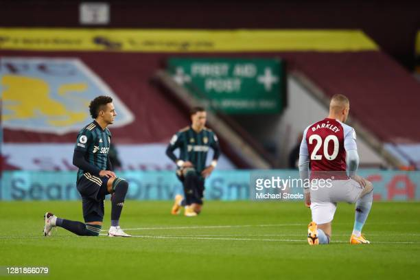 Rodrigo Moreno of Leeds United and Ross Barkley of Aston Villa take a knee in support of the Black Lives Matter movement during the Premier League...