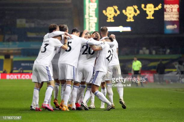 Rodrigo Moreno of Leeds United celebrates with team mates after scoring his sides first goal during the Premier League match between Leeds United and...