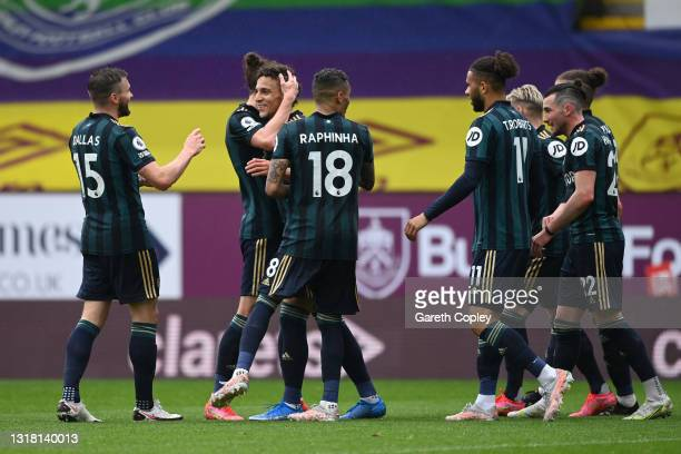 Rodrigo Moreno of Leeds United celebrates with team mates after scoring their side's third goal during the Premier League match between Burnley and...