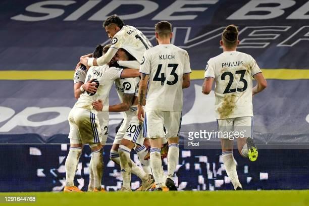 Rodrigo Moreno of Leeds United celebrates with teammates Jack Harrison, Raphinha and EzgjanAlioski after scoring their team's second goal during the...