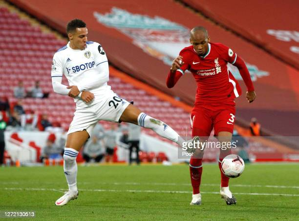 Rodrigo Moreno of Leeds United fouls Fabinho of Liverpool leading to Liverpool being award a penalty during the Premier League match between...