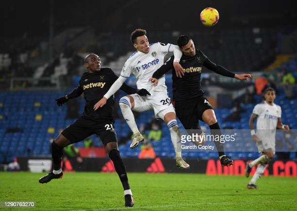 Rodrigo Moreno of Leeds United heads the ball wide whilst under pressure from Angelo Ogbonna and Fabian Balbuena of West Ham United during the...