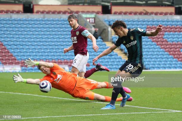 Rodrigo Moreno of Leeds United scores their side's fourth goal past Bailey Peacock-Farrell of Burnley during the Premier League match between Burnley...