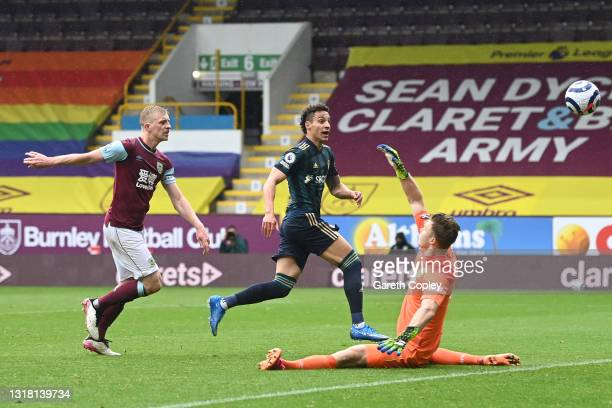 Rodrigo Moreno of Leeds United scores their side's third goal past Bailey Peacock-Farrell of Burnley during the Premier League match between Burnley...