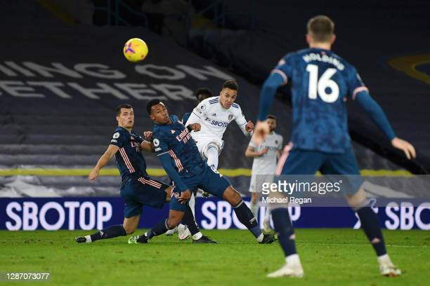 Rodrigo Moreno of Leeds United shoots and hits the cross bar whilst under pressure from Gabriel and Granit Xhaka of Arsenal during the Premier League...
