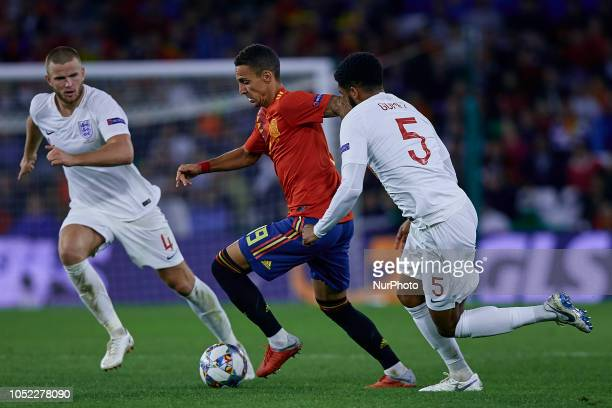 Rodrigo Moreno of Spain competes for the ball with Joe Gomez and Eric Dier of England during the UEFA Nations League A group four match between Spain...