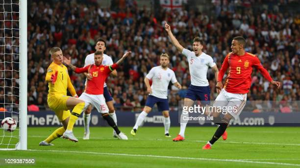 Rodrigo Moreno of Spain scores his team's second goal past Jordan Pickford of England during the UEFA Nations League A group four match between...