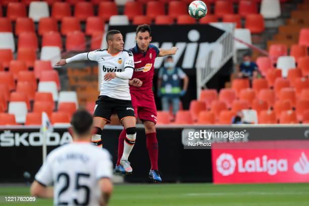 Rodrigo Moreno of Valencia CF and Unai Garcia of CA Osasuna during La Liga match between Valencia CF and CA Osasuna at Mestalla Stadium on June 21...