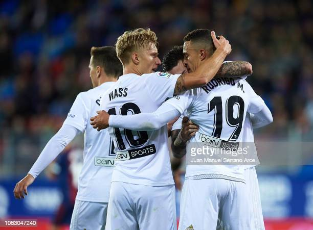 Rodrigo Moreno of Valencia CF celebrates with his teammate Daniel Wass and Santiago Mina of Valencia CF after scoring the opening goal during the La...