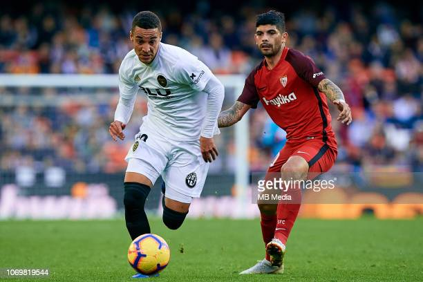 Rodrigo Moreno of Valencia CF competes for the ball with Ever Banega of Sevilla FC during the La Liga match between Valencia CF and Sevilla FC at...