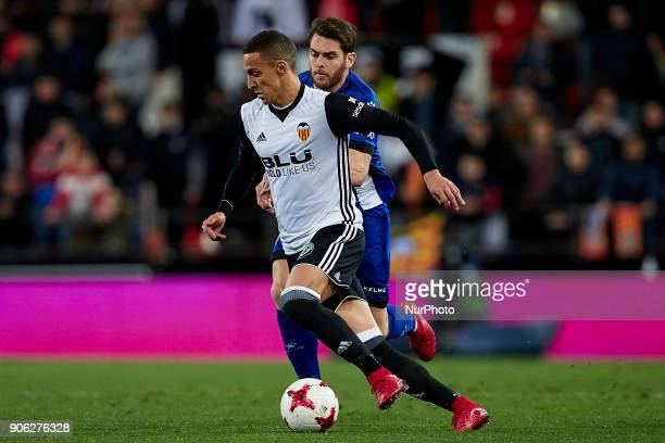 Rodrigo Moreno of Valencia CF competes for the ball with Ibai Gomez of Deportivo Alaves during the Copa del Rey quarterfinal first leg game between...