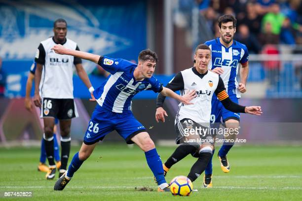 Rodrigo Moreno of Valencia CF duels for the ball with Adrian Dieguez of Deportivo Alaves during the La Liga match between Deportivo Alaves and...