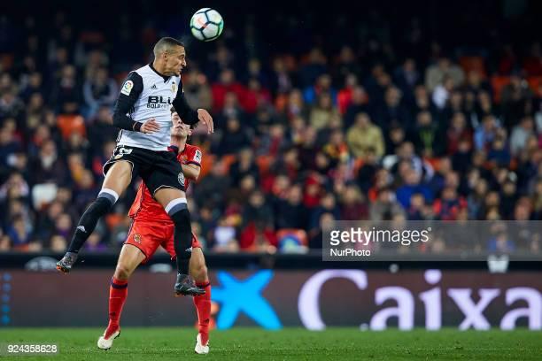 Rodrigo Moreno of Valencia CF heads the ball next to Odriozola of Real Sociedad during the La Liga match between Valencia CF and Real Sociedad at...
