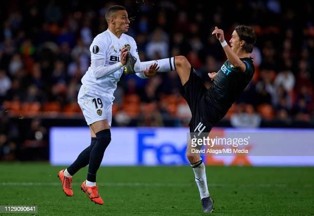 Rodrigo Moreno of Valencia CF in action next to Kristoffer Olsson of Krasnodar during the UEFA Europa League Round of 16 First Leg match between...