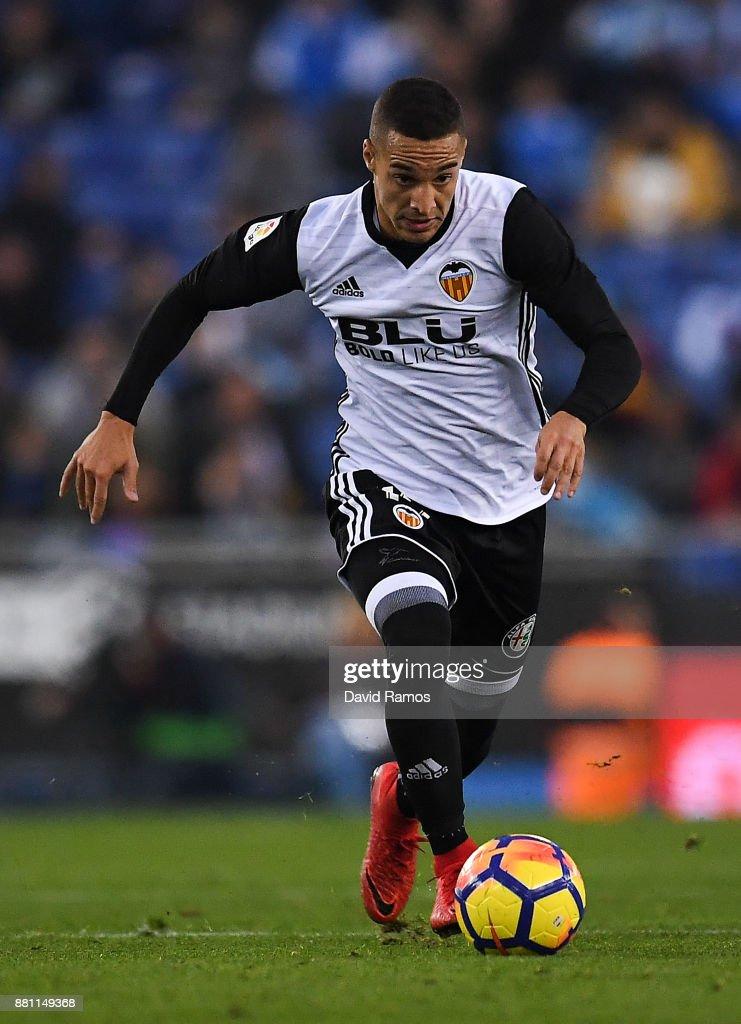 Rodrigo Moreno of Valencia CF runs with the ball during the La Liga match between Espanyol and Valencia at Cornella - El Prat stadium on November 19, 2017 in Barcelona, Spain.
