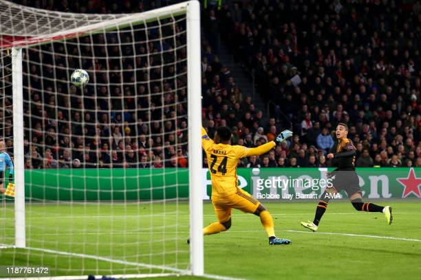 Rodrigo Moreno of Valencia CF scores a goal to make it 0-1 during the UEFA Champions League group H match between AFC Ajax and Valencia CF at...