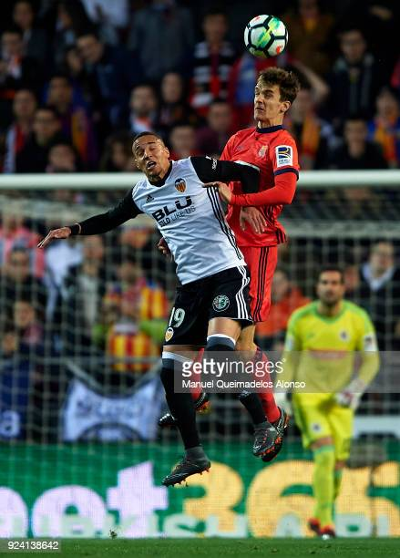 Rodrigo Moreno of Valencia competes for the ball with Diego Llorente of Real Sociedad during the La Liga match between Valencia CF and Real Sociedad...