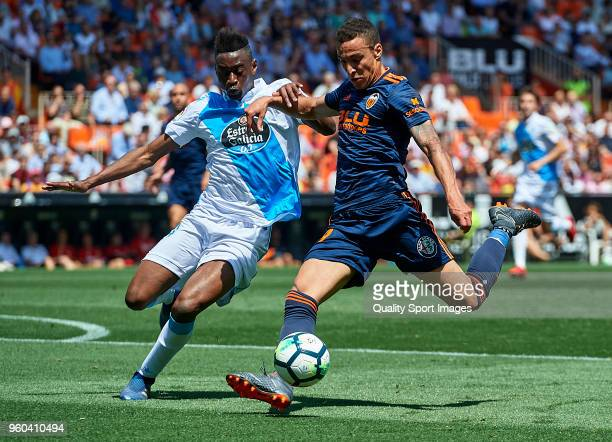 Rodrigo Moreno of Valencia competes for the ball with Mujaid of Deportivo de La Coruna during the La Liga match between Valencia and Deportivo La...