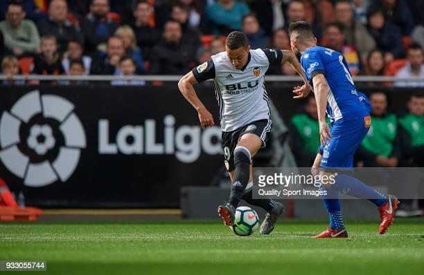 Rodrigo Moreno of Valencia competes for the ball with Ruben Duarte of Alaves during the La Liga match between Valencia and Deportivo Alaves at...