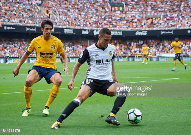 Rodrigo Moreno of Valencia competes fot the ball with Stefan Savic of Atletico Madrid during the La Liga match between Valencia and Atletico Madrid...