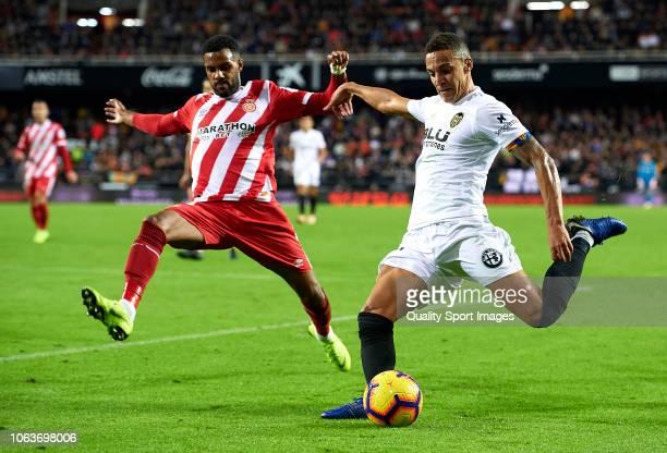 Rodrigo Moreno of Valencia is closed down by Jonas Ramalho of Girona during the La Liga match between Valencia CF and Girona FC at Estadio Mestalla...