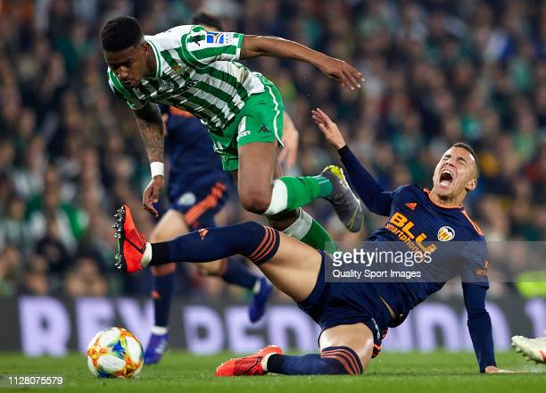 Rodrigo Moreno of Valencia is tackled by Junior Firpo of Real Betis during the Copa del Rey Semi Final first leg match between Real Betis and...