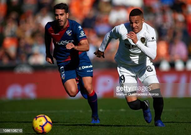 Rodrigo Moreno of Valencia runs with the ball during the La Liga match between Valencia CF and SD Huesca at Estadio Mestalla on December 23 2018 in...
