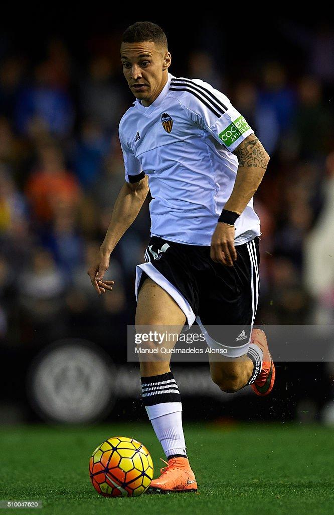 Rodrigo Moreno (L) of Valencia runs with the ball during the La Liga match between Valencia CF and RCD Espanyol at Estadi de Mestalla on February 13, 2016 in Valencia, Spain.