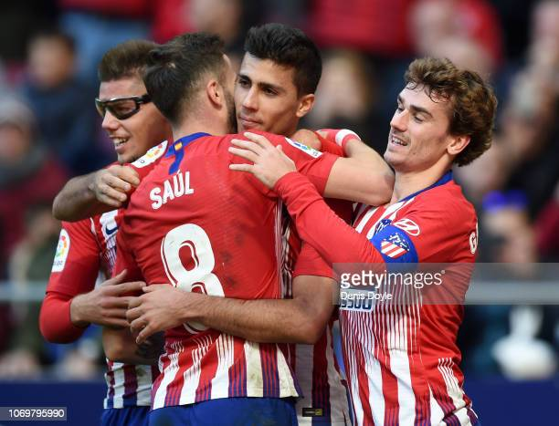 Rodrigo of Atletico Madrid celebrates after scoring his team's third goal with his team mates during the La Liga match between Club Atletico de...