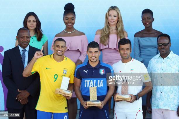 Rodrigo of Brazil Gabriele Gori of Italy and Mohammad Ahmadzadeh of Iran pose with their individual awards after the FIFA Beach Soccer World Cup...