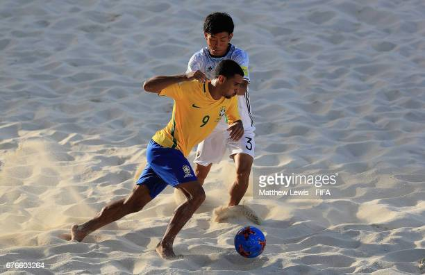 Rodrigo of Brazil looks to beat Shotaro Haraguchi of Japan during the FIFA Beach Soccer World Cup Bahamas 2017 group D match between Braziland Japan...
