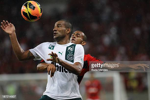 Rodrigo of Goias competes for the ball with Diego Silva of Flamengo during the Brazilian Cup 2013 Semifinal between Flamengo and Goias at Maracana...