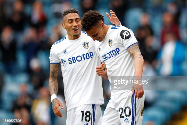 Rodrigo of Leeds United celebrates after scoring their sides first goal with team mate Raphinha during the Premier League match between Leeds United...