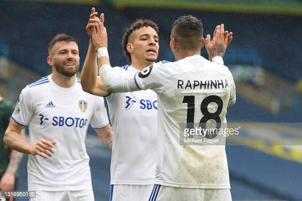 Rodrigo of Leeds United celebrates with Raphinha after scoring their side's third goal during the Premier League match between Leeds United and...