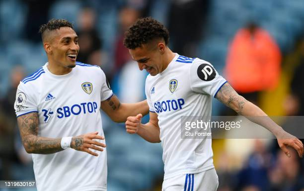 Rodrigo of Leeds United celebrates with team mate Raphinha after scoring his team's first goal during the Premier League match between Leeds United...